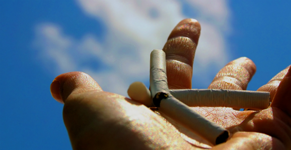 hand with crushed cigarette